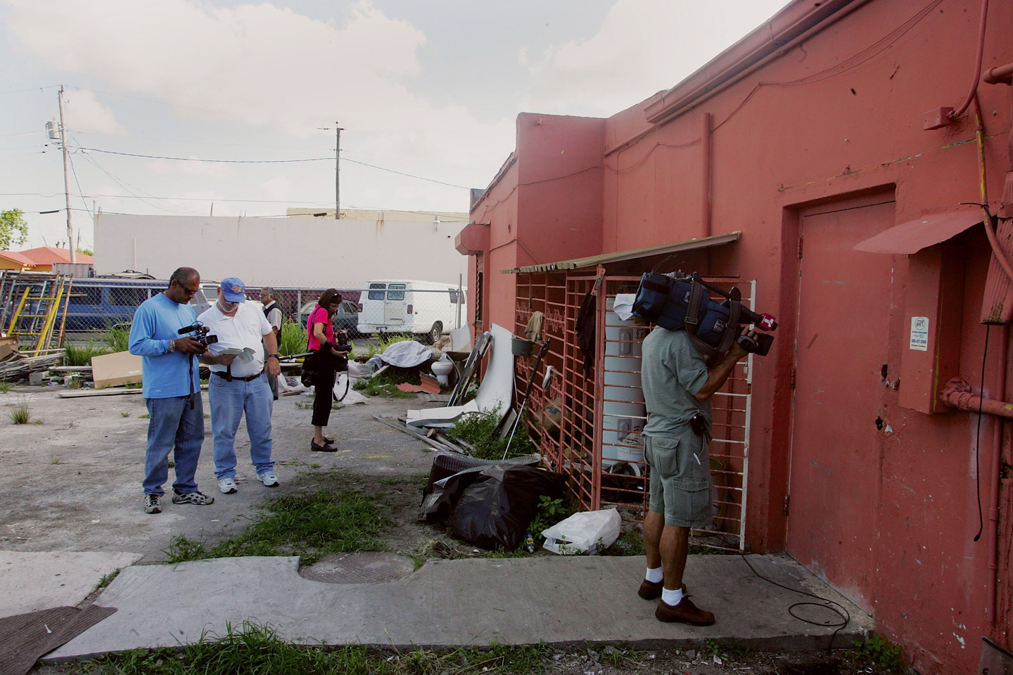 MIAMI - JUNE 23:  Media stands outside the warehouse that the FBI raided last evening June 23, 2006 in the Liberty CIty neighborhood of Miami, Florida. The U.S. Justice Department was expected to provide details of an alleged plot to attack the Chicago Sears Tower, in which at least seven people who were staying in the warehouse were arrested in Miami.  (Photo by Joe Raedle/Getty Images)