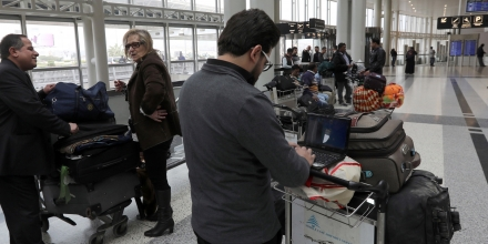 A Syrian passenger travelling to the United States through Amman types on his laptop before entering Beirut international airport's departure lounge on March 22,2017.Hours after the US government warned that extremists plan to target passenger jets with bombs hidden in electronic devices, and banned carrying them in cabins on flights from 10 airports in eight countries in the Middle East and North Africa, Britain tightened airline security on flights from the same region, banning laptops and tablet computers from the plane cabin. / AFP PHOTO / ANWAR AMRO (Photo credit should read ANWAR AMRO/AFP/Getty Images)