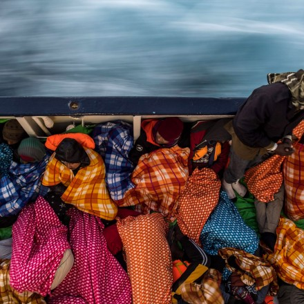 AT SEA - FEBRUARY 18:  Refugees and migrants sleep on the deck of the Spanish NGO Proactiva Open Arms rescue vessel Golfo Azzurro after being rescued off  Libyan coast north of Sabratha, Libya on February 18, 2017 at Sea. 466 migrants have been rescued in high seas since yesterday evening by the Italian Coast Guard and the Spanish NGO Proactiva Open Arms rescue vessel Golfo Azzurro as they continue to search for more boats. Proactiva Open Arms are a Spanish charity based out of Malta who provide search and rescue assistance to refugees and migrants in distress at sea. They patrol the SAR and Rescue Zone off the coast of Libya running rescue missions for the hundreds of migrants who continue to make the perilous journey across the Mediterranean in the hope of reaching the European mainland.  (Photo by David Ramos/Getty Images)