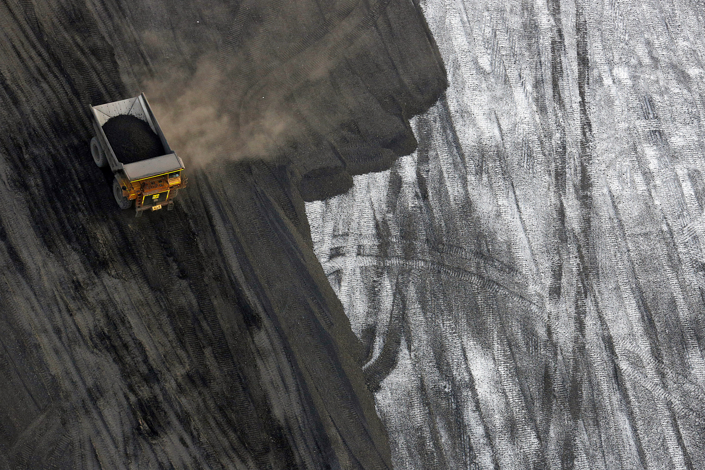 A dump truck moves coal in this aerial photograph taken above the Peabody Energy Corp. Francisco mine in Francisco, Indiana, U.S., on Tuesday, April 5, 2016. Peabody filed for bankruptcy on Wednesday, the most powerful convulsion yet in an industry that's still waiting for the coal market to bottom out. Photographer: Luke Sharrett/Bloomberg via Getty Images