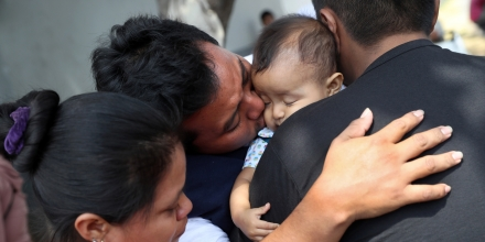 GUATEMALA CITY, GUATEMALA - FEBRUARY 09: Guatemalan deportee Eric Perez, 23, kisses his daughter Kimberly, 18 months, after he arrived on an ICE deportation flight on February 9, 2017 to Guatemala City, Guatemala. The charter jet, carrying 135 deportees, arrived from Texas, where U.S. border agents catch the largest number illigal immigrants crossing into the United States, many of them from Central America. The Guatemalan Exterior Ministry gives the deportees phone calls to their family, lunch and a ride to their towns upon their return. U.S. President Donald Trump pledged to vastly increase the number of deportations as part of his platform to crack down on illegal immigration. (Photo by John Moore/Getty Images)