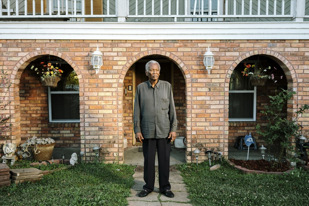 "Reserve, LA - Feb 24, 2017 - Robert ""Bobby"" Taylor (76) stands in the front yard of his home on E 26th Street. Taylor is the President of the Concerned Citizens of St. John Parish, a community organizing group."