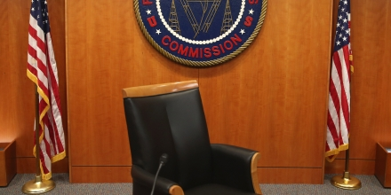 WASHINGTON, DC - FEBRUARY 26:  The seal of the Federal Communications Commission hangs behind commissioner Tom Wheeler's chair inside the hearing room at the FCC headquarters February 26, 2015 in Washington, DC. The Commission will vote on Internet rules, grounded in multiple sources of the Commissions legal authority, to ensure that Americans reap the benefits of an open Internet.  (Photo by Mark Wilson/Getty Images)