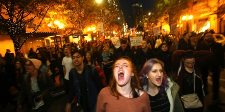 SEATTLE, WA - NOVEMBER 09: Sasha Savenko (C) and Sydney Kane (C, Right), both students at the University of Washington, join thousands of protesters march down 2nd Avenue on November 9, 2016 in Seattle, Washington. Demostrations in multiple cities around the country were held the day following Donald Trump's upset win in last night's U.S. presidential election.  (Photo by Karen Ducey/Getty Images)