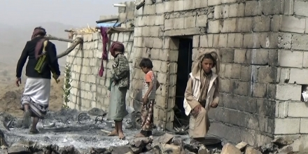 In this Feb. 3, 2017 frame grab from video, residents inspect a house that was damaged during a Jan. 29, 2017 US raid on the tiny village of Yakla, in central Yemen. The main figure killed in the US raid in Yemen targeting al-Qaida was a tribal leader allied to the country's U.S.- and Saudi-backed president who was helping fight Shiite rebels, according to military officials and tribal figures. The raid, which left at least 25 Yemenis dead and a US Navy Seal, showed how difficult it is to tell who is al-Qaida in a country where the militants are mingled with tribes and are fighting on the same side as the government against the rebels. (AP Photo)