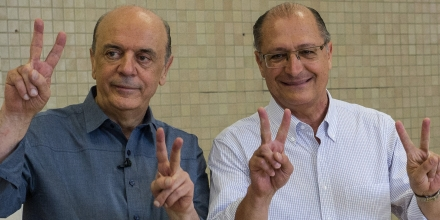 Sao Paulo state governor Geraldo Alckmin(R) poses with the mayoral candidate of the Brazilian Social Democracy Party (PSDB), Jose Serra (L), after casting his vote in Sao Paulo, Brazil on October 07, 2012. Brazilians trooped to the polls early Sunday to vote in nationwide municipal elections seen as a key test of the ruling Workers Party's popularity ahead of the 2014 presidential elections. AFP PHOTO/YASUYOSHI CHIBA        (Photo credit should read YASUYOSHI CHIBA/AFP/GettyImages)