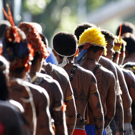 Mundurukus natives opposed to the construction of the controversial Belo Monte dam in the state of Para arrive at the Planalto Palace in Brasilia on June 4, 2013 to hold a meeting with Brazil's Secretary General of the Presidency, Gilberto Carvalho. Five indigenous tribes are calling for legislation under which they would have to be consulted prior to any official decision affecting them with respect to the dam's construction. Belo Monte, which is being built at a cost of $13 billion, is expected to flood an area of 500 square km along the Xingu River, displacing 16,000 people, according to the government. Some NGOs have estimated that some 40,000 people would be displaced by the massive project. Indigenous groups say the dam will harm their way of life while environmentalists warn of deforestation, greenhouse gas emissions and irreparable damage to the ecosystem.  AFP PHOTO/Beto BARATA        (Photo credit should read BETO BARATA/AFP/Getty Images)