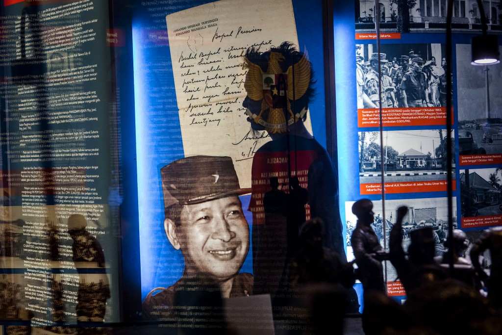 YOGYAKARTA, INDONESIA - MAY 06:  A visitor walks pass a picture of Soeharto at Soeharto museum on May 06, 2016 in Yogyakarta, Indonesia.  Survivors of Indonesia's anti-communist massacres in 1965 called for investigations on the country's purges, in which hundreds of thousands of people are believed to have been killed by the Indonesian military when the Cold War was escalating in Southeast Asia. Based on human rights groups, half a million people died in 1965 during a massacre carried out by the military and religious groups after an attempted coup by suspected communists, where an officer-led group kidnapped and executed six generals on the night of Septemeber 30, 1965. Known as one of the worst mass atrocities of the 20th century, many among the dead had no connection to Communism, and hundreds of thousands had been held in dentention centers for years during the period. (Photo by Ulet Ifansasti/Getty Images)