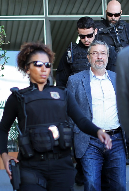 Antonio Palocci, a former Brazilian finance minister and senior figure in the last two governments, is pictured upon arriving under police escort at the Forensic Medicine Institute in Curitiba, in southern Brazil, on September 26, 2016, after being arrested in Sao Paulo for his alleged involvement in the huge Petrobras pay-to-play scandal.Brazilian police on Monday arrested Palocci, as part of the Petrobras corruption probe, prosecutors said. Palocci, 55, served as finance minister under former president Luiz Inacio Lula da Silva and as chief of staff for his successor Dilma Rousseff, who was impeached this month. Palocci was also a key figure in the leftist Workers' Party. / AFP / Heuler Andrey (Photo credit should read HEULER ANDREY/AFP/Getty Images)