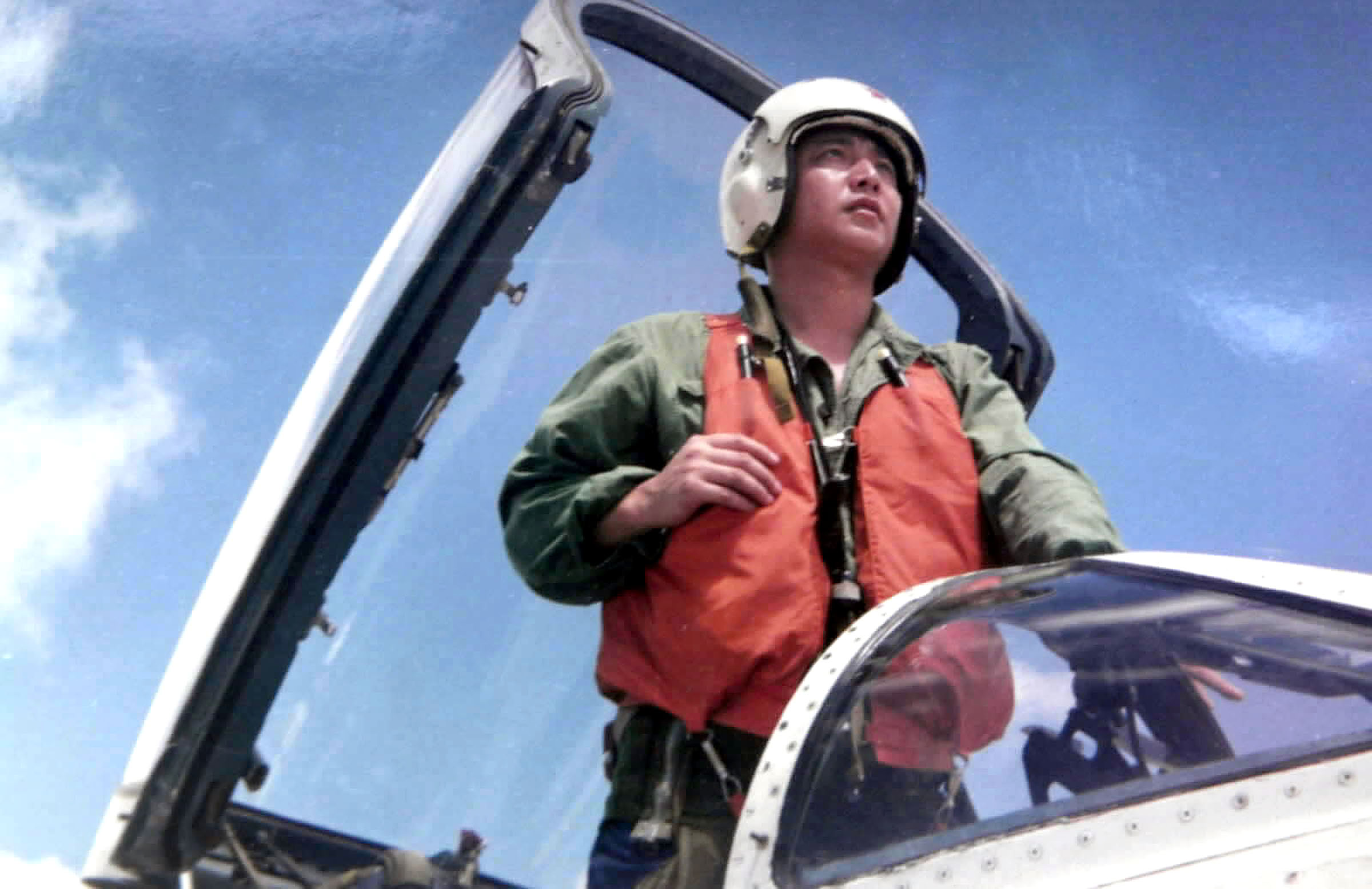 387645 01: Undated File Photo: Chinese Pilot Wang Wei Stands In The Cockpit Of A Jet. After A Collision With A U.S. Navy Surveillance Plane April 1, 2001 Chinese Officials Reported That Wang Parachuted Out Of His Fighter Jet Over The South China Sea And Is Presumed Dead, April 9.  (Photo By Getty Images)