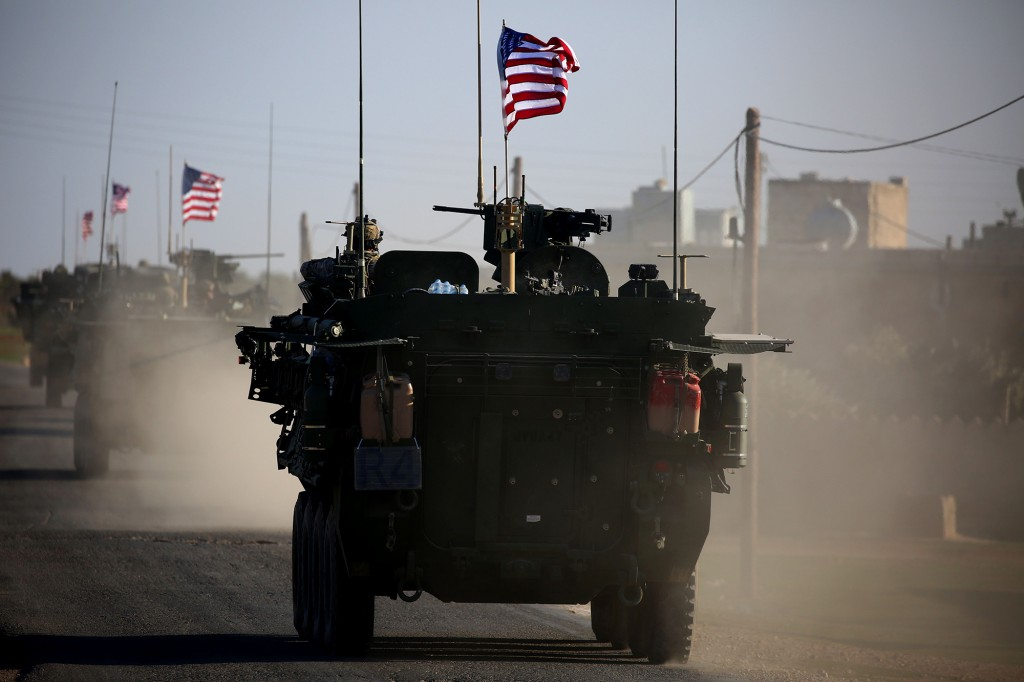 TOPSHOT - A convoy of US forces armoured vehicles drives near the village of Yalanli, on the western outskirts of the northern Syrian city of Manbij, on March 5, 2017. / AFP PHOTO / DELIL SOULEIMAN        (Photo credit should read DELIL SOULEIMAN/AFP/Getty Images)