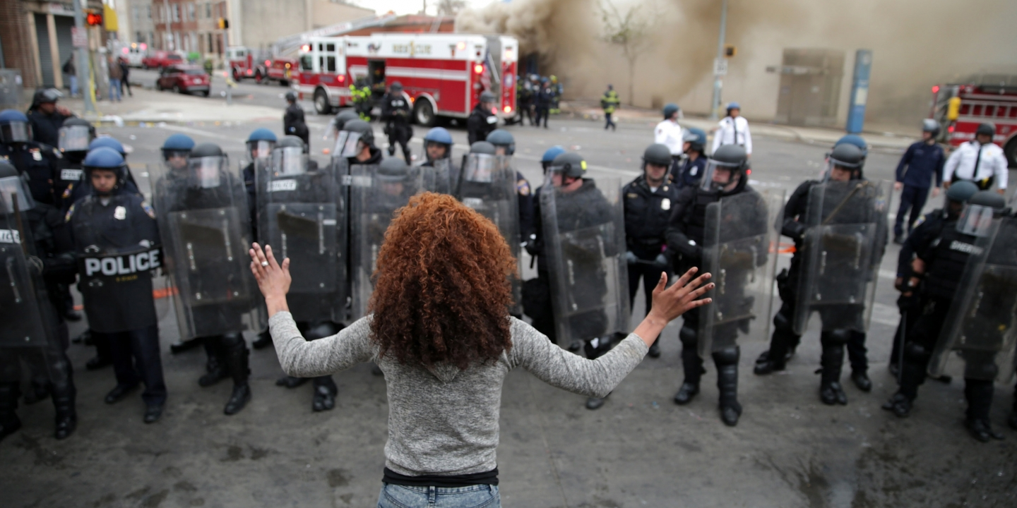 Baltimore police officers in riot gear push protestors back along - Baltimore Md April 27 A Woman Faces Down A Line Of Baltimore Police