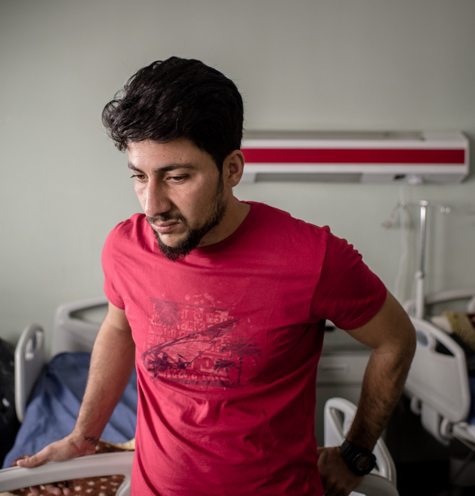 Ala'a Ali, 28, stands in his 4-year-old daughter Awra's hospital room at West Erbil Emergency in Erbil, Iraq on April 10, 2017.