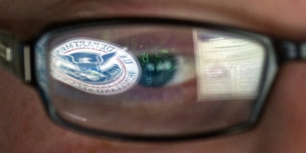 FILE - In this Sept. 30, 2011 file photo, a reflection of the Department of Homeland Security logo is seen reflected in the glasses of a cyber security analyst in the watch and warning center at the Department of Homeland Security's secretive cyber defense facility at Idaho National Laboratory, which is intended to protect the nation's power, water and chemical plants, electrical grid and other facilities from cyber attacks, in Idaho Falls, Idaho. The federal government's plan to expand computer security protections into critical parts of private industry is raising concerns that the move will threaten Americans' civil liberties. Cybersecurity has become a rapidly expanding priority for the government as federal agencies, private companies and everyday people come under persistent and increasingly sophisticated computer attacks. (AP Photo/Mark J. Terrill, File)