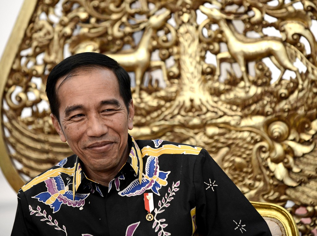 This picture taken on March 27, 2017 shows Indonesian President Joko Widodo reacting to a question during an exclusive interview with AFP at the Merdeka Palace in Jakarta. / AFP PHOTO / GOH CHAI HIN        (Photo credit should read GOH CHAI HIN/AFP/Getty Images)