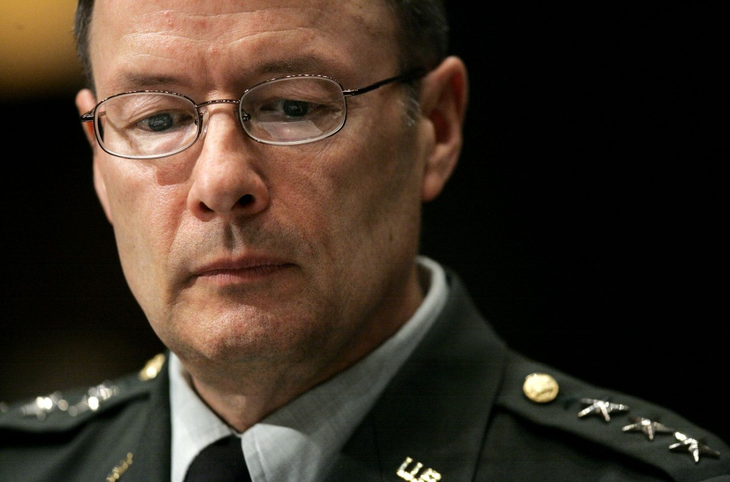 Army Lt. Gen. Keith Alexander, director of the National Security Agency, reviews his notes, while testifying on Capitol Hill in Washington, Tuesday, May 1, 2007, before the Senate Intelligence Committee. (AP Photo/Haraz N. Ghanbari)