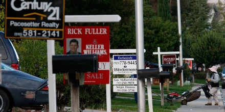 Real estate for sale signs are seen in front of homes that were foreclosed along Catanzaro Way in Antioch, California, on Oct. 15, 2007.