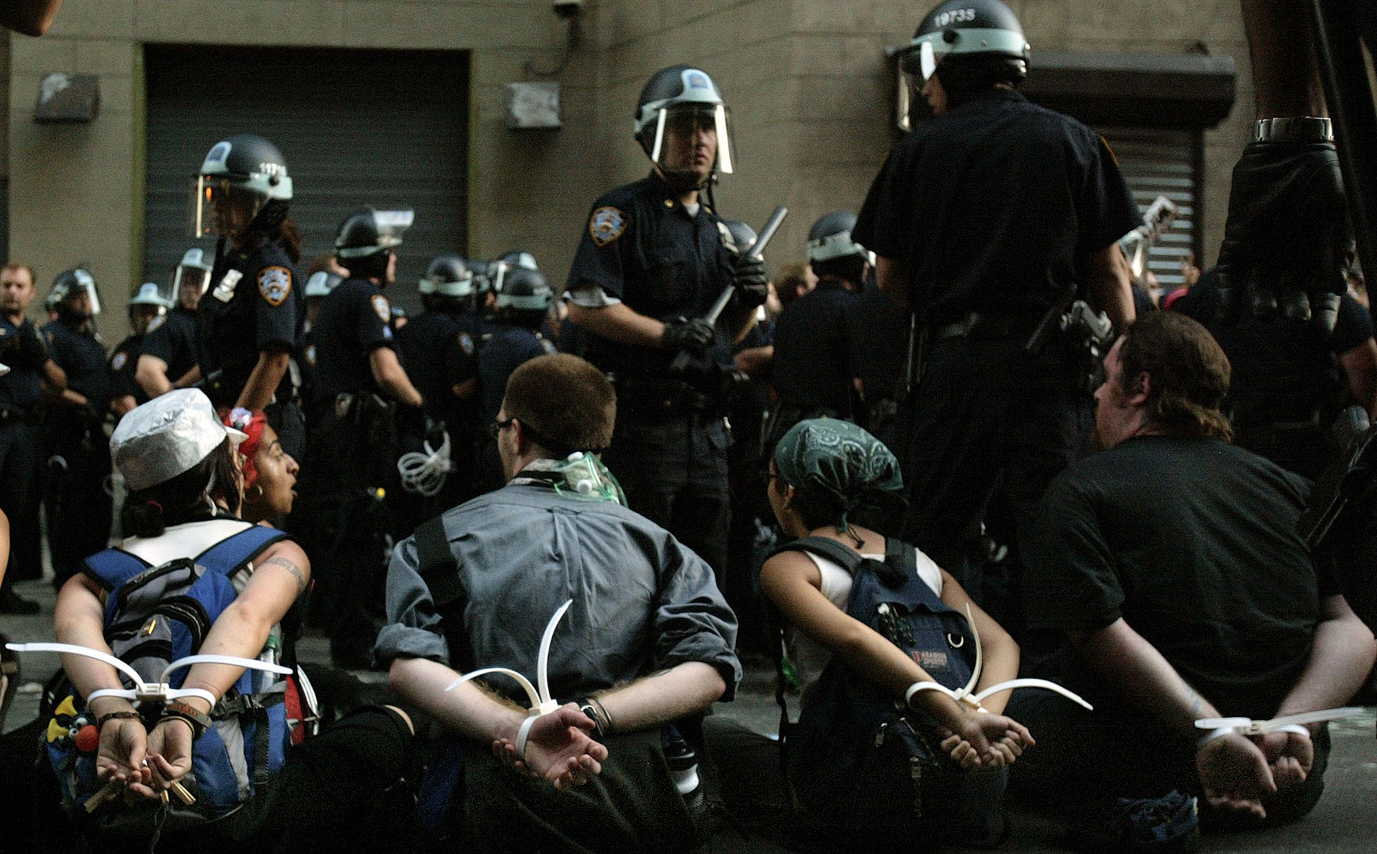 NEW YORK - AUGUST 31:  Protesters are arrested at Union Square after attempting to march without a permit August 31,2004 in New York City. More than 260 people were arrested today, the second day of the Republican National Convention being held at Madison Square Garden.  (Photo by Paula Bronstein/Getty Images)