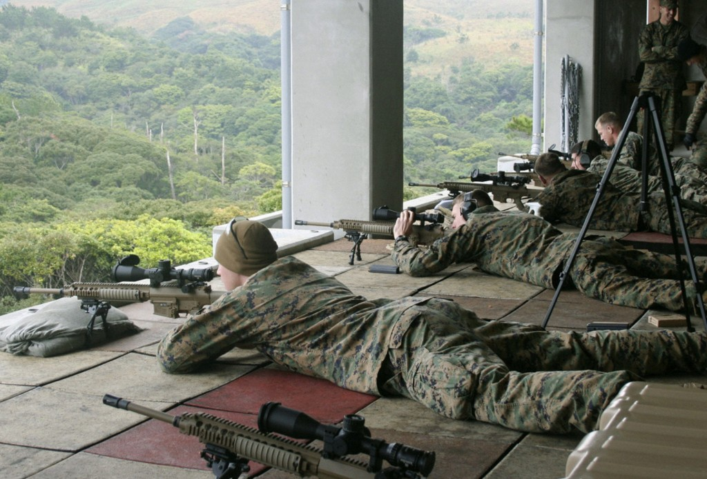NAHA, Japan - Members of the U.S. Marine Corps test fire M110 rifles, the newest model, at Camp Hansen in Okinawa Prefecture on Jan. 12, 2011. (Kyodo)