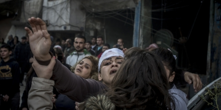 2757513 12/12/2015 Residents and relatives of the victims on the site of the terrorist act in downtown Homs. On December 12, terrorists staged a deadly car bomb attack near the Al-Ahli hospital. Valeriy Melnikov/Sputnik via AP