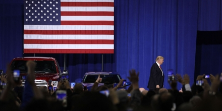 YPSILANTI, MI- MARCH 15:  U.S. President Donald Trump is cheered by auto workers at the American Center for Mobility March 15, 2017 in Ypsilanti, Michigan. Trump discussed his priorities of improving conditions to bolster the manufacturing industry and reduce the outsourcing of American jobs. (Photo by Bill Pugliano/Getty Images)