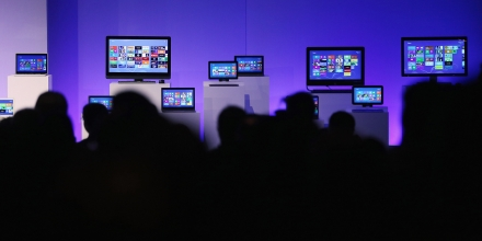 NEW YORK, NY - OCTOBER 25:  People sit in front of devices running the Microsoft Windows 8 operating system at a press conference launch of the system on October 25, 2012 in New York City.  Windows 8 will offer a touch interface in an effort to bridge the gap between tablets, smartphones and personal computers. Microsoft will also be selling a tablet called Surface to compete in the competitive tablet market.  (Photo by Mario Tama/Getty Images)
