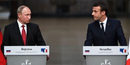 Russian President Vladimir Putin (L) and French President Emmanuel Macron (R) look at each other during a joint press conference in the Galerie des Batailles (Gallery of Battles) following their meeting at the Versailles Palace, near Paris, on May 29, 2017.French President Emmanuel Macron hosts Russian counterpart Vladimir Putin in their first meeting since he came to office with differences on Ukraine and Syria clearly visible. / AFP PHOTO / CHRISTOPHE ARCHAMBAULT (Photo credit should read CHRISTOPHE ARCHAMBAULT/AFP/Getty Images)