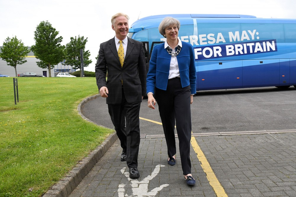 Britain's Prime Minister Theresa May (R) is greeted by local Conservative candidate, Kevin Horkin as she arrives in the constituency of Hyndburn in Accrington, Lancashire county on May 30, 2017. / AFP PHOTO / POOL / Leon Neal        (Photo credit should read LEON NEAL/AFP/Getty Images)