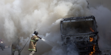 Firefighters work to extinguish a truck allegedly set on fire by drug traffickers in Rio de Janeiro, Brazil, Tuesday, May 2, 2017. Several public buses were torched in Rio de Janeiro on Tuesday in what Brazilian military police said was likely gang retaliation for a large anti-drug operation. (AP Photo/Silvia Izquierdo)