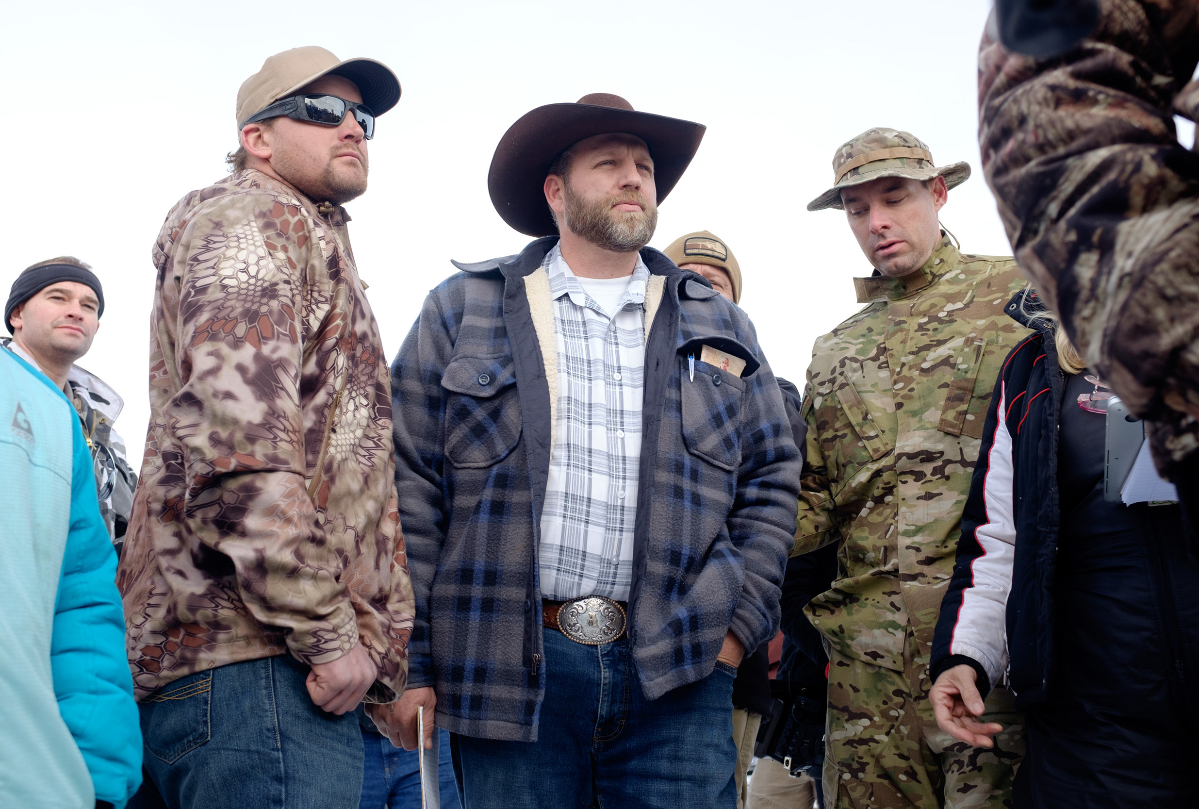Ammon Bundy(C), leader of a group of armed anti-government protesters speaks to the media as other members look on at the Malheur National Wildlife Refuge near Burns, Oregon January 4, 2016. The FBI on January 4 sought a peaceful end to the occupation by armed anti-government militia members at a US federal wildlife reserve in rural Oregon, as the standoff entered its third day. The loose-knit band of farmers, ranchers and survivalists -- whose action was sparked by the jailing of two ranchers for arson -- said they would not rule out violence if authorities stormed the site, although federal officials said they hope to avoid bloodshed. AFP PHOTO / ROB KERR / AFP / ROB KERR        (Photo credit should read ROB KERR/AFP/Getty Images)