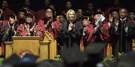 Bethune-Cookman University president Edison Jackson, left, and United States Secretary of Education Betsy DeVos applaud students as they are introduced during commencement exercises, Wednesday, May 10, 2017, in Daytona Beach, Fla. (AP Photo/John Raoux)