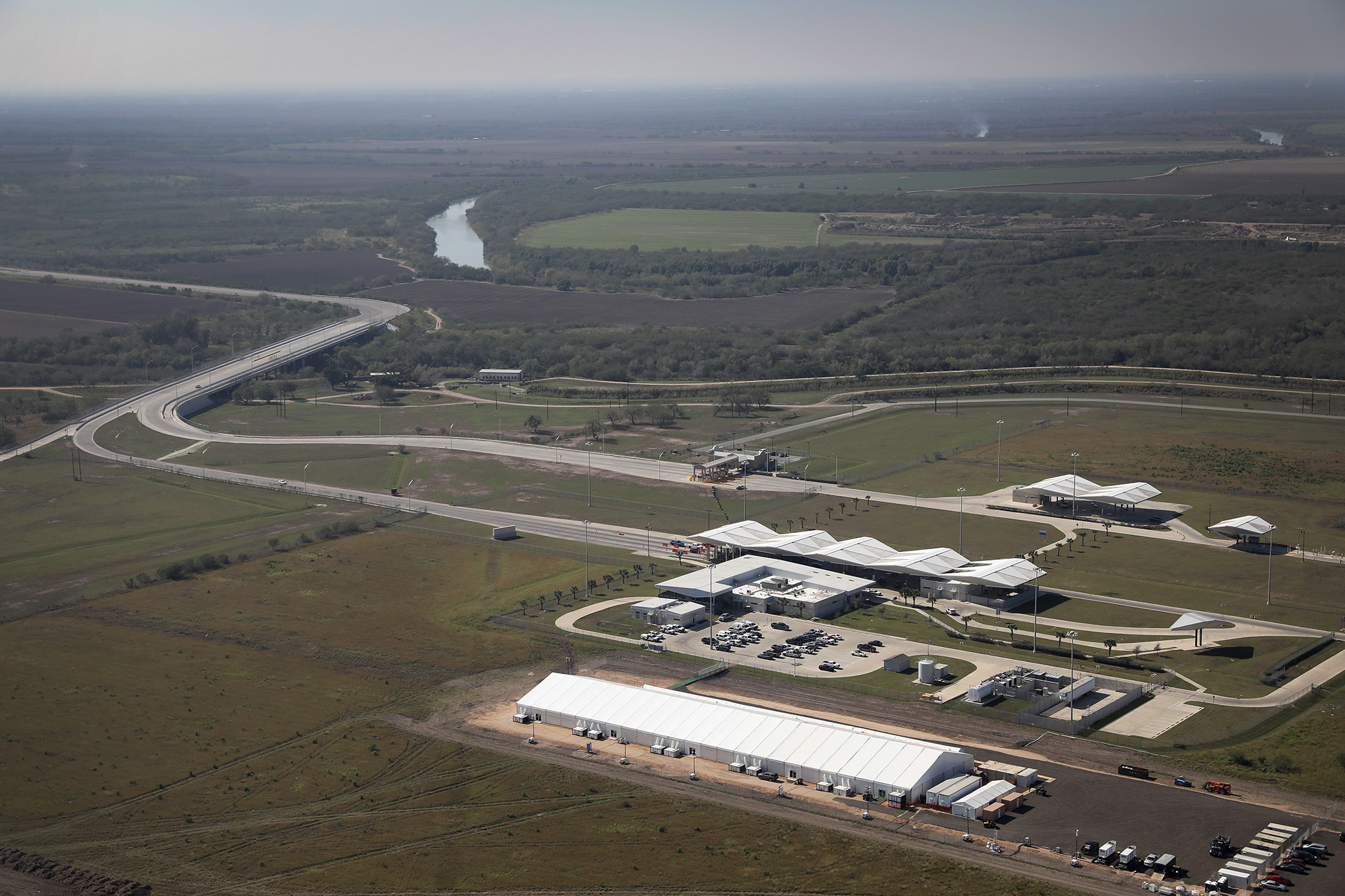 DONNA, TX - JANUARY 03:  A new temporary detention center for immigrants (lower right), awaits new arrivals on January 3, 2017 in Donna, Texas. The center, located near the Donna-Rio Bravo international bridge at the Rio Grande in Donna, Tx, can hold up to 500 people. U.S. Customs and Border Protection built the facility to provide additional temporary housing for unaccompanied children and families, most from Central America, who have been surging across the border seeking asylum from violence and poverty in their countries.  (Photo by John Moore/Getty Images)