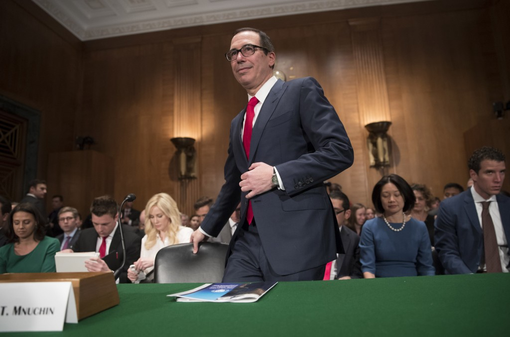 Treasury Secretary Steven Mnuchin arrives on Capitol Hill in Washington, Thursday, May 18, 2017, to testify before the Senate Banking Committee hearing on tax overhaul. (AP Photo/J. Scott Applewhite)
