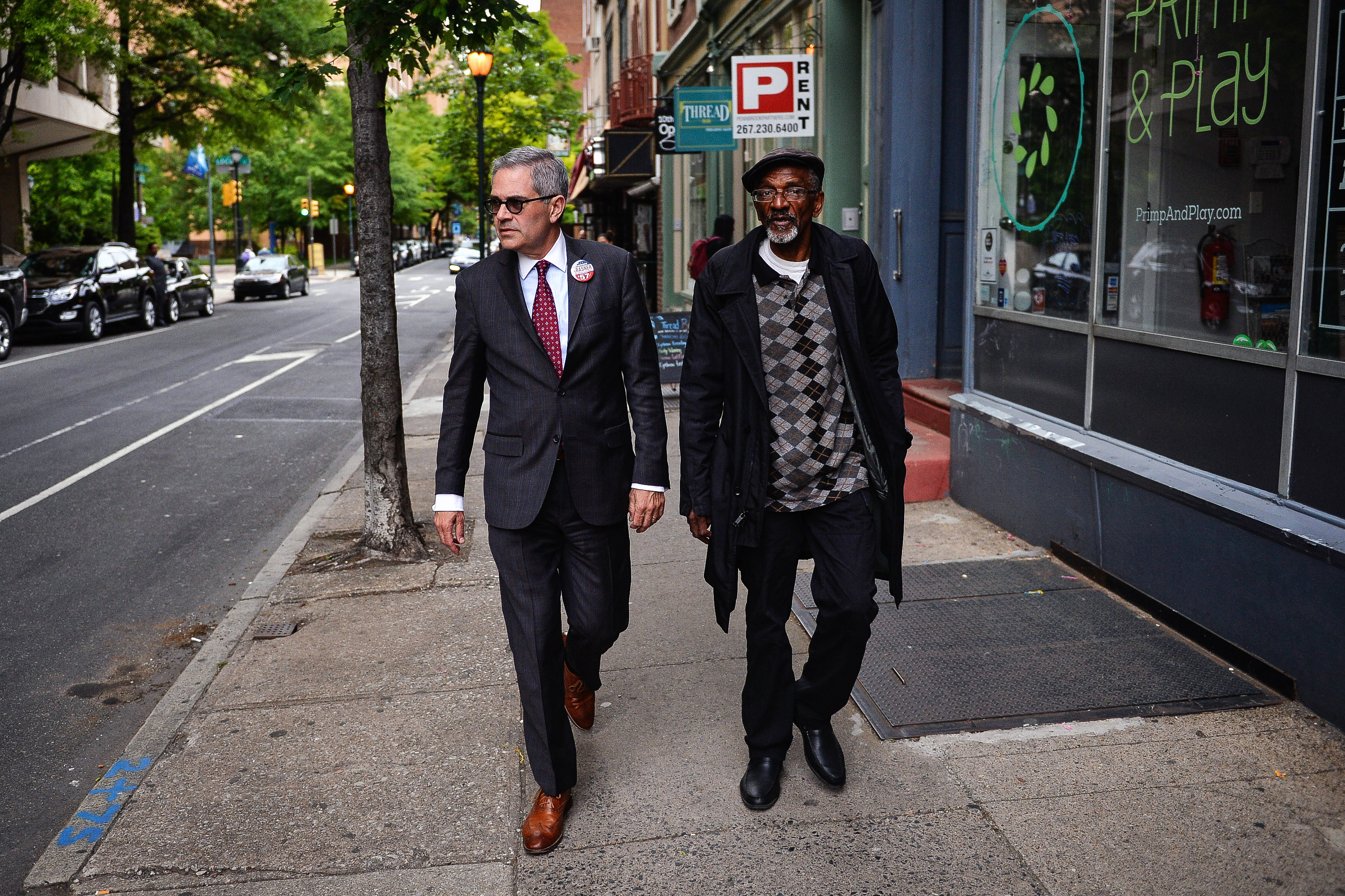 Philadelphia District Attorney candidate Lawrence Krasner and Wayne Jacobs, founder of X-Offenders Community Empowerment, walk together to a campaign event in Philadelphia, PA, Thursday, May 11, 2017.Charles Mostoller for the Intercept