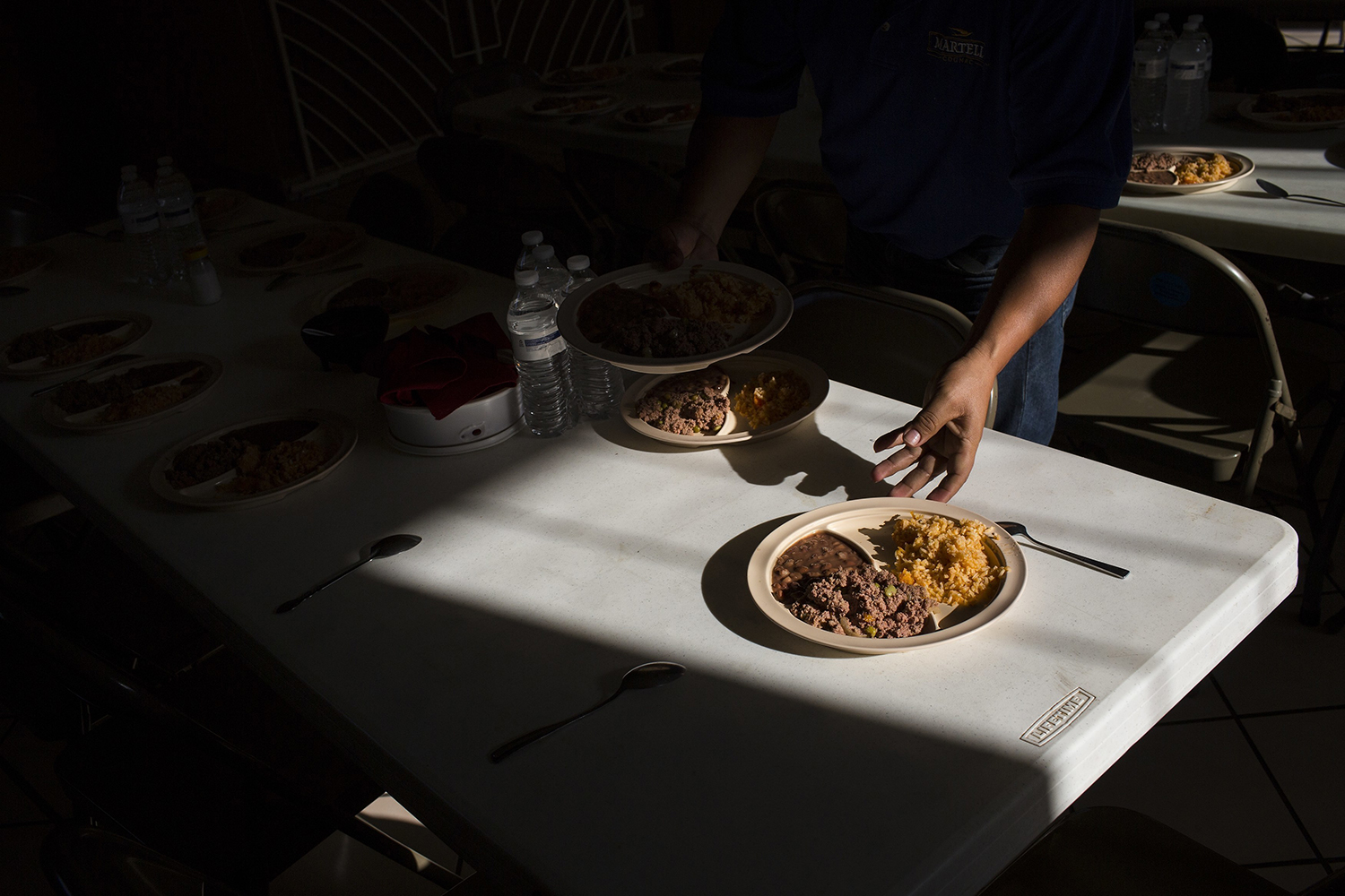 "Migrants have a dinner of rice and beans at the migrant shelter ""Casa del Migrante"" in Nuevo Laredo, Tamaulipas state, Mexico, Saturday, March 25, 2017, across the border from Laredo, Texas. Some Cubans have been stuck here since then-President Barack Obama on Jan. 12 ended the so-called ""wet foot, dry foot"" policy that had given Cubans a privileged path to the U.S. Until then, nearly any Cubans reaching U.S. soil had the right to stay, but now they are treated like migrants from other nations, facing a much tougher barrier. (AP Photo/Rodrigo Abd)"