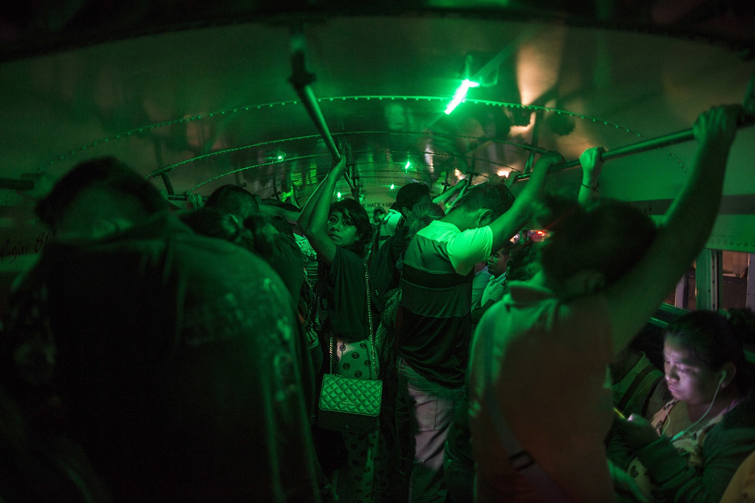 "People stand in a bus waiting to go home after their work day at a ""maquiladora"" for car accessories in Matamoros, Tamaulipas state, Mexico, Tuesday, March 21, 2017, across the border from Brownsville, Texas. (AP Photo/Rodrigo Abd)"