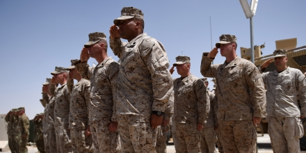 US Marines salute during a handover ceremony at Leatherneck Camp in Lashkar Gah in the Afghan province of Helmand on April 29, 2017.US Marines returned to Afghanistan's volatile Helmand April 29, where American troops faced heated fighting until NATO's combat mission ended in 2014, as embattled Afghan security forces struggle to beat back the resurgent Taliban. The deployment of some 300 Marines to the poppy-growing southern province came one day after the militants announced the launch of their