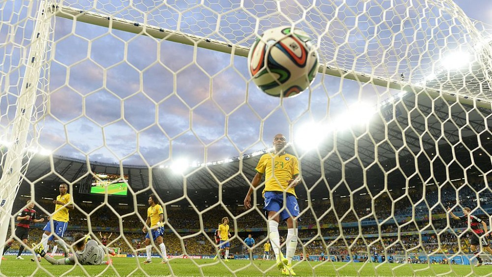 Brazil's goalkeeper Julio Cesar (L bottom) concedes a goal during the semi-final football match between Brazil and Germany at The Mineirao Stadium in Belo Horizonte during the 2014 FIFA World Cup on July 8, 2014. Germany won 7-1.  AFP PHOTO / ADRIAN DENNIS        (Photo credit should read ADRIAN DENNIS/AFP/Getty Images)