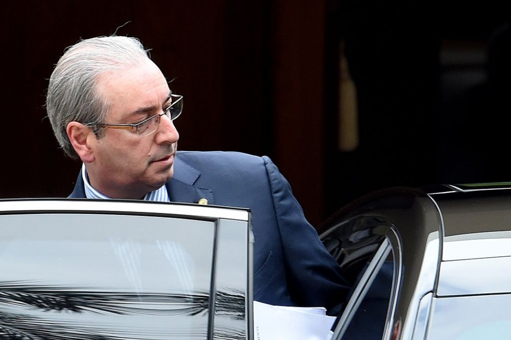 The president of the Brazilian chamber of deputies, Eduardo Cunha leaves the official residence on his way to the Congress in Brasilia on December 17, 2015. The Attorney General of the Republic, Rodrigo Janot, presented to the Federal Supreme Court (STF) a request for precautionary removal of Eduardo Cunha from the position of Congressman and Speaker of the House.  AFP PHOTO/EVARISTO SA / AFP / EVARISTO SA        (Photo credit should read EVARISTO SA/AFP/Getty Images)