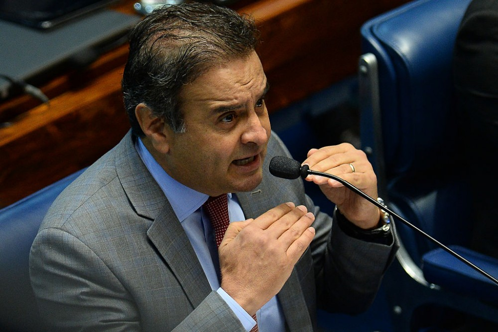Senator Aecio Neves speaks during the third day of the Senate impeachment trial of Brazilian suspended President Dilma Rousseff at the National Congress in Brasilia on August 27, 2016.<br /><br /><br /><br /><br /> Brazil's first woman president, Dilma Rousseff, faces the final act of an impeachment battle likely to see the suspended leader of Latin America's biggest economy sacked within days. / AFP / ANDRESSA ANHOLETE        (Photo credit should read ANDRESSA ANHOLETE/AFP/Getty Images)