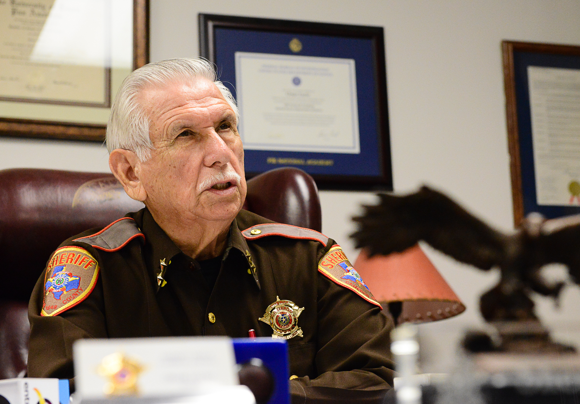 Cameron County Sheriff Omar Lucio speaks to the media at a conference on Wednesday, July 20, 2016, in Brownsville, Texas. Lucio discussed two recent incidents, an armed robbery in La Feria, and an arrest of two young men who are now charged with transporting narcotics in Brownsville. (Jason Hoekema/The Brownsville Herald via AP)