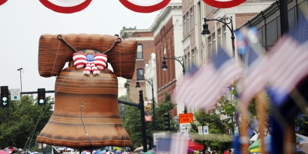 A Liberty Bell float looms high over spectators in the 2015 Fourth of July Parade in Pittsfield, Mass., on Saturday, July 4, 2015. (Stephanie Zollshan/The Berkshire Eagle via AP)