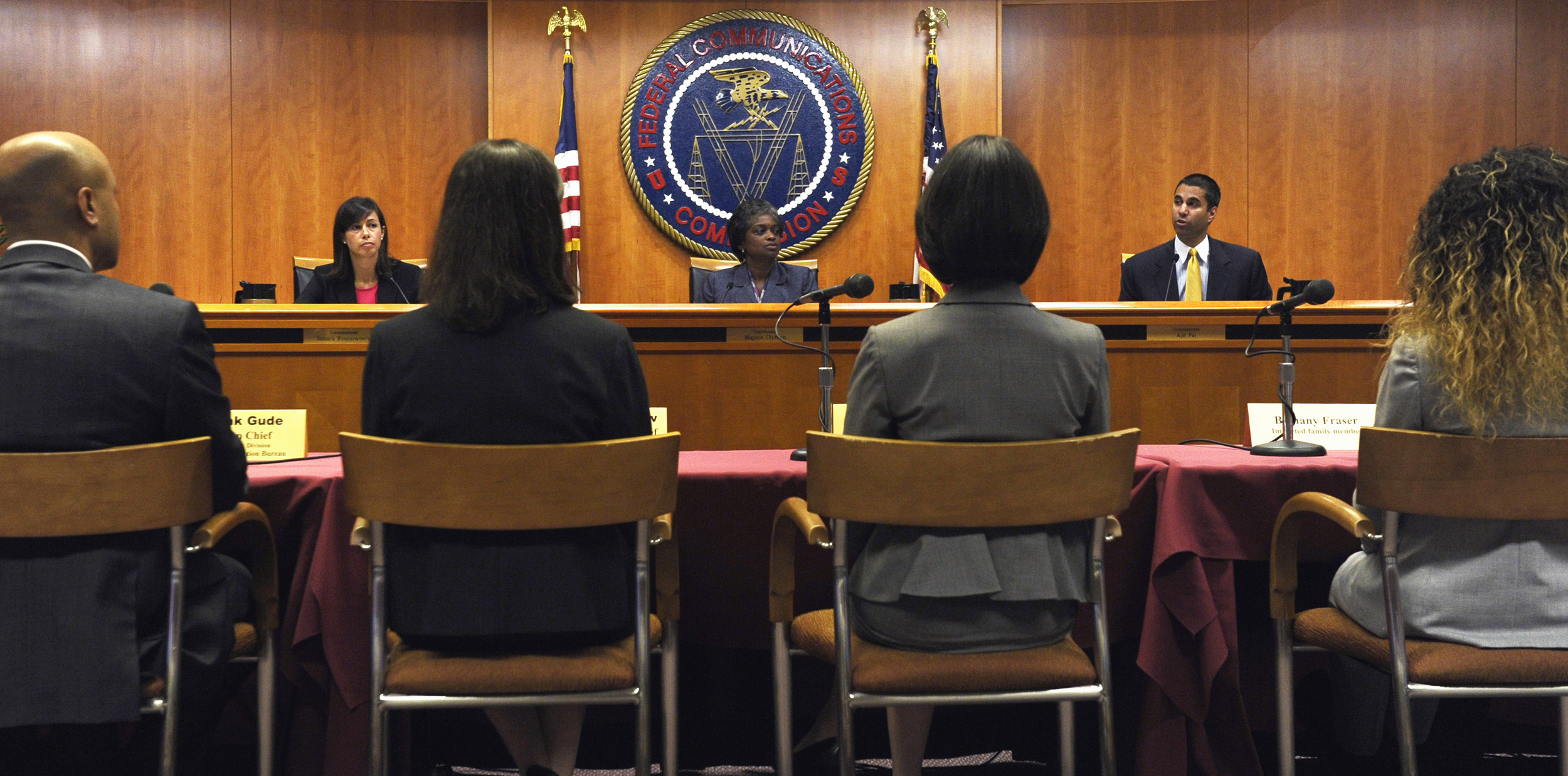 Federal Communications Commission (FCC) Chair Mingon Clyburn, center, flanked by Commissioners Jessica Rosenworcel, left, and Ajit Pai, participates in a hearing at the FCC in Washington, Friday, Aug. 9, 2013. The FCC approved limits on rates that prison inmates pay to make phone calls. The FCC voted 2-1 Friday - a decade after inmates' families asked for action.  (AP Photo/Susan Walsh)