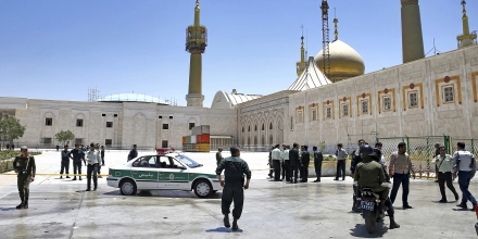 Police officers control the scene, around of shrine of late Iranian revolutionary founder Ayatollah Khomeini, after an assault by several attackers in Tehran, just outside Tehran, Iran, Wednesday, June 7, 2017. Suicide bombers and gunmen stormed into Iran's parliament and targeted the shrine of Ayatollah Ruhollah Khomeini on Wednesday, killing a security guard and wounding several other people in rare twin attacks, with the siege at the legislature still underway. (AP Photo/Ebrahim Noroozi)