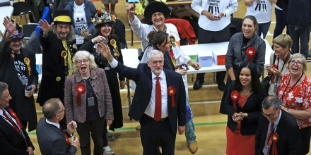 Britain's Labour party leader Jeremy Corbyn, bottom center, waves after arriving for the declaration at his constituency in London, Friday, June 9, 2017. Britain voted Thursday in an election that started out as an attempt by Prime Minister Theresa May to increase her party's majority in Parliament ahead of Brexit negotiations but was upended by terror attacks in Manchester and London during the campaign's closing days. (AP Photo/Frank Augstein)