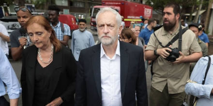 LONDON, ENGLAND - JUNE 15:  Labour leader Jeremy Corbyn visits the scene of the Grenfell Tower fire with new Labour MP for Kensington, Emma Dent Coad (L), on June 15, 2017 in London, England. At least 17 people have been confirmed dead and dozens missing, after the 24 storey residential Grenfell Tower block in Latimer Road was engulfed in flames in the early hours of June 14. The number of fatalities are expected to rise.  (Photo by Jack Taylor/Getty Images)