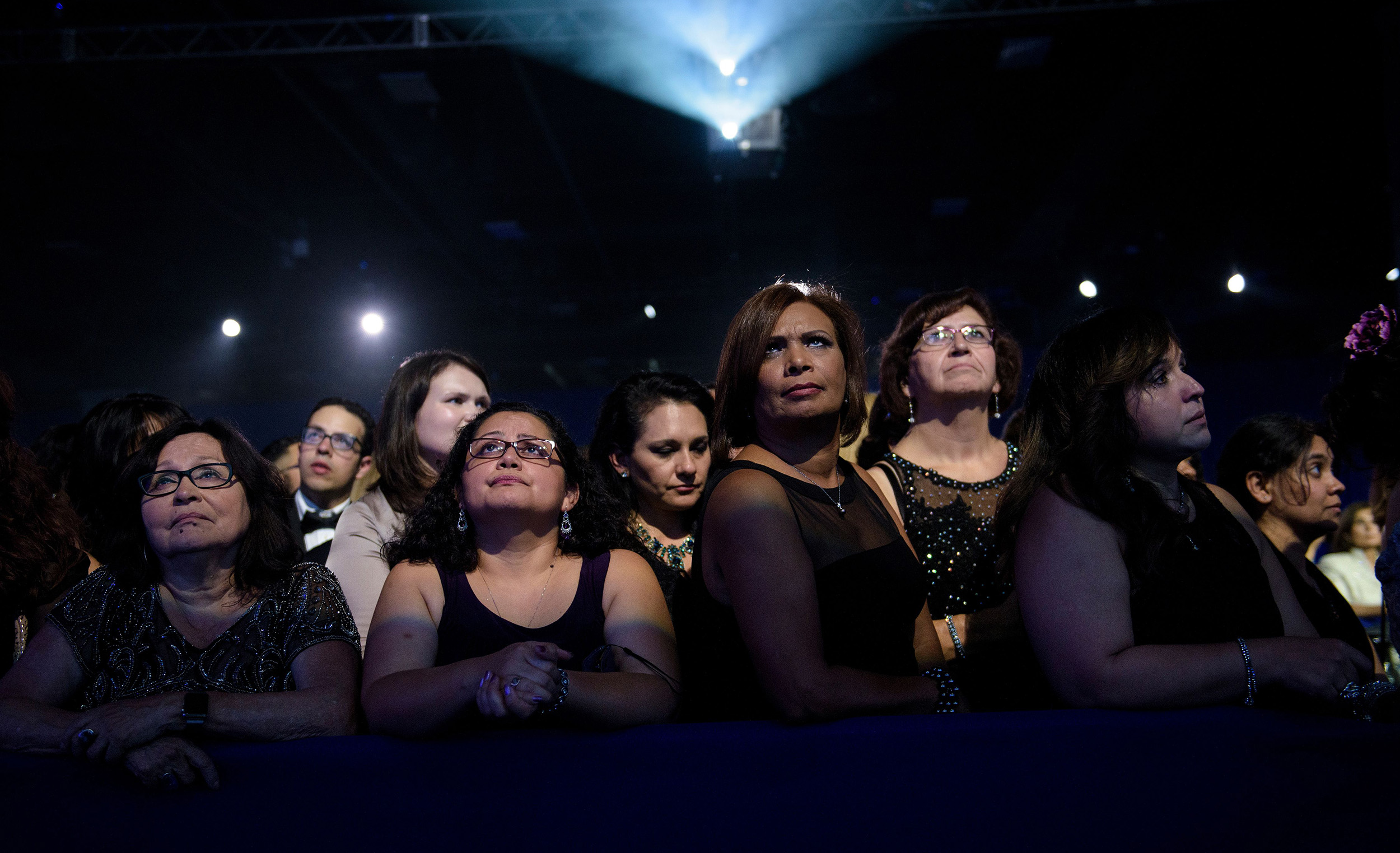 TOPSHOT - People listen as Democratic presidential nominee Hillary Clinton speaks during the Congressional Hispanic Caucus Gala September 15, 2016 in Washington.Hillary Clinton returned Thursday to the campaign fray in a tightening race against Republican Donald Trump, who released new details of his physical fitness in response to the health scare that sidelined his rival. / AFP / Brendan Smialowski (Photo credit should read BRENDAN SMIALOWSKI/AFP/Getty Images)