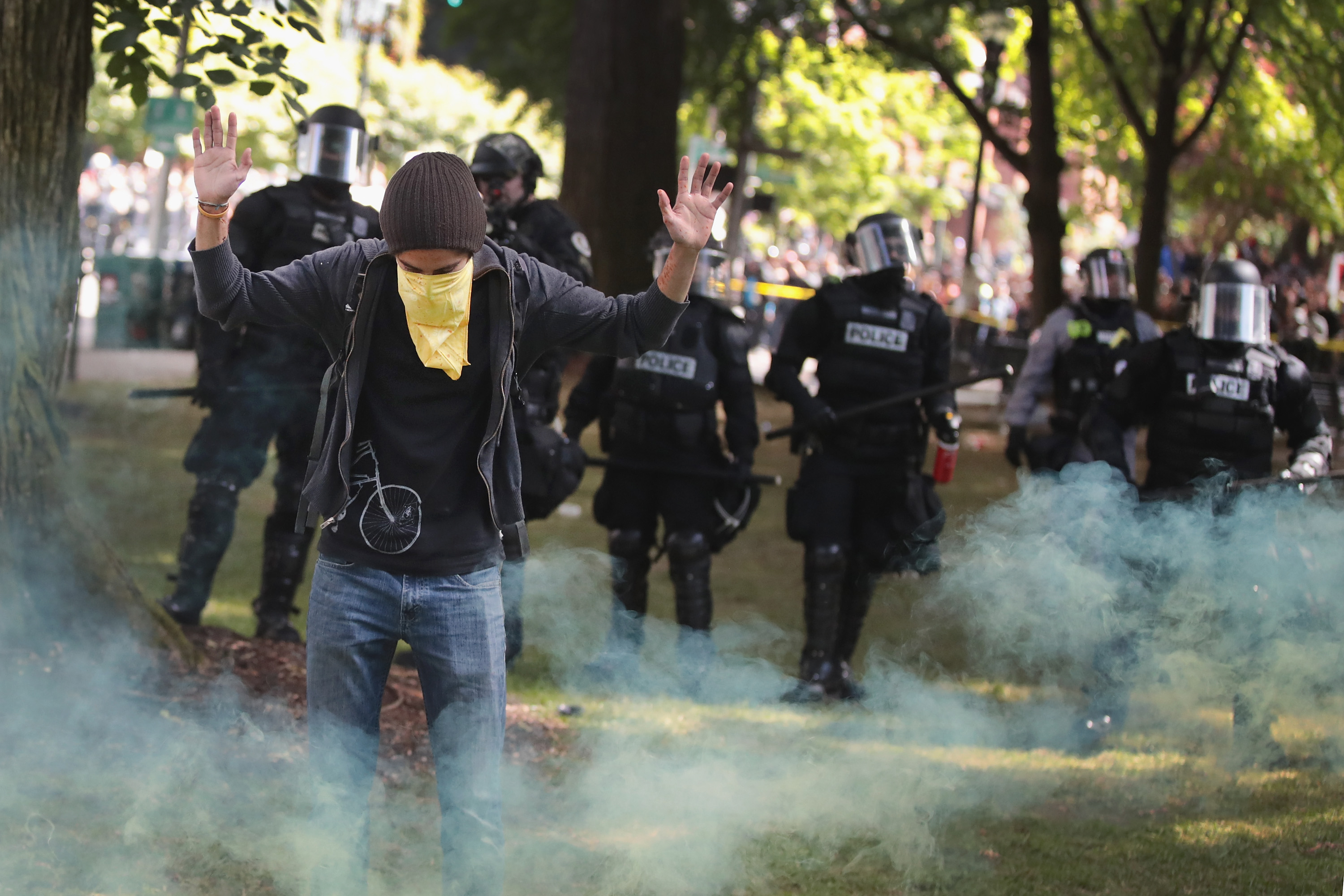 "PORTLAND, OR - JUNE 04:  Antifascist demonstrators confront police during a protest on June 4, 2017 in Portland, Oregon. A protest dubbed ""Trump Free Speech"" by organizers was met by a large contingent of counter-demonstrators who viewed the protest as a promotion racism. Many residents of Portland are still coming to terms with the recent violent attack on the city's MAX train line when Ricky Best, 53, and Taliesin Namkai-Meche, 23, were stabbed to death and Micah Fletcher,21, was severely injured after they tried to protect two teenage girls, one of whom was wearing a hijab, from being harassed with racial taunts by suspect Jeremy Christian.  (Photo by Scott Olson/Getty Images)"