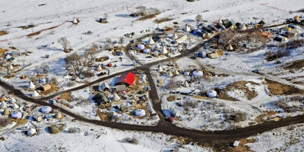 In this aerial photo the Sacred Stones Camp on the Standing Rock Indian Reservation and along the Cannonball River, where people have gathered to protest the Dakota Access oil pipeline, is seen in Cannon Ball, N.D., Monday, Feb. 13, 2017. A federal judge on Monday refused to stop construction on the last stretch of the Dakota Access pipeline, which is progressing much faster than expected. (Tom Stromme/The Bismarck Tribune via AP)