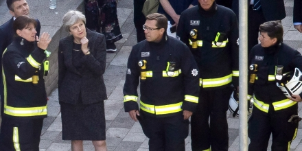 LONDON, ENGLAND - JUNE 15:  Prime Minister Theresa May speaks to Dany Cotton, Commissioner of the London Fire Brigade, with members of the fire service as she visits Grenfell Tower, on June 15, 2017 in London, England. At least twelve people have been confirmed dead and dozens missing, after the 24 storey residential Grenfell Tower block in Latimer Road was engulfed in flames in the early hours of June 14. The number of fatalities are expected to rise.  (Photo by Dan Kitwood/Getty Images)
